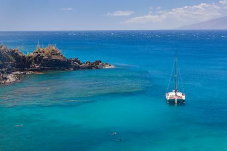 Snorkeling and diving at Honolua Bay, Maui, Hawaii.