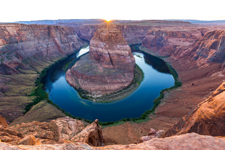 Sunset at the Horseshoe bend is a Horseshoe shaped incised meander of the Colorado river, Page, Arizona.