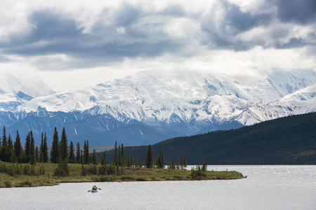 Kayak in Wonder Lake with Mt. McKinley in the background, Denali National Park Alaska, USA. Stock Photo