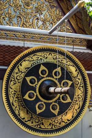 expel: Big Gong use expel to darkness to decorate Wat Gold Mountain, Thailand
