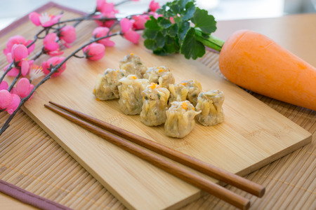 dim: shumai, dim sum On a wooden tray Stock Photo