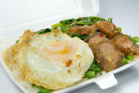 kana: Thai popular menu for packed lunch, Kana Moo Grob Khai Dao. Stri-fried crispy pork with Kale, eat with steamed rice and fried egg. Stock Photo