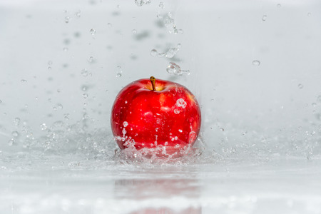 capture the moment: Make the apple looks fresher by splash the water to them and capture the moment.
