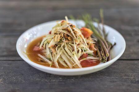 Thai som tam papaya salad on table