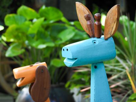 Wooden deer in the garden