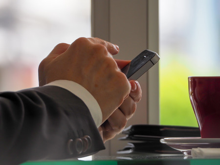 using smartphone in coffee shop