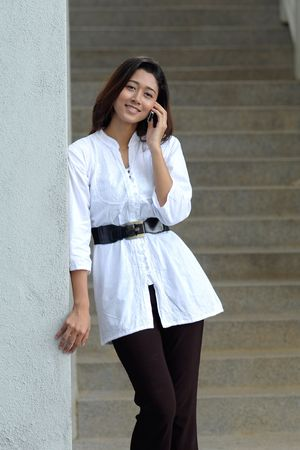 Pretty girl talking on the phone Stock Photo - 9052240