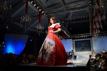 in conjunction: KUALA LUMPUR, MALAYSIA - APRIL 2: A model displays a dress by Dominique Chan during STYLO Fashion Grand Prix at Chin Woo Stadium April 2, 2011 in Kuala Lumpur, Malaysia.The fashion show was held in conjunction with Malaysian F1 Grand Prix. Editorial