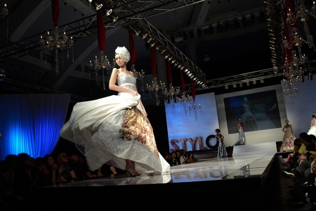 KUALA LUMPUR, MALAYSIA - APRIL 2: A model displays a dress by Dominique Chan during STYLO Fashion Grand Prix at Chin Woo Stadium April 2, 2011 in Kuala Lumpur, Malaysia.The fashion show was held in conjunction with Malaysian F1 Grand Prix. Editorial