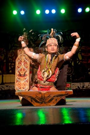 KUCHING, SARAWAK, MALAYSIA - FEB 25 : The Iban Warrior perform the ngajat (tribal dance) at the Sarawak Cultural Village on February 25, 2012 in Santubong, Sarawak.