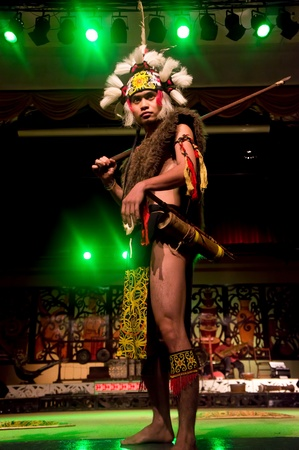 KUCHING, MALAYSIA - FEB 25 : Warrior from the indigenous Iban people performs a traditional dance at the Sarawak Cultural Village, February 25, 2012 in Kuching, Sarawak, Malaysia.