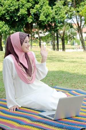 Woman with her laptop in the park