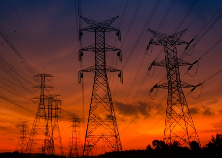 Electricity pylons and amazing color of sunset