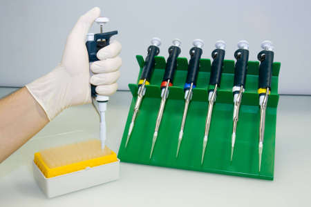 A set of pipettes, tips in the box, putting a tip on a pipette Stock Photo - 2255444