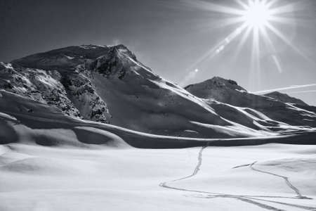 blackwhite: Winter mountain landscape sunlit. Sunshine. Black and white. Davos, canton Graubenden, Swiss Alps