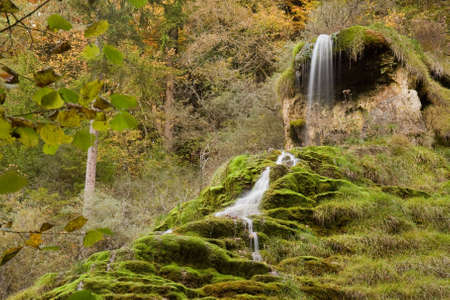 Waterfall in a forest. Tuefels Chilen. Autumn. Switzerland photo