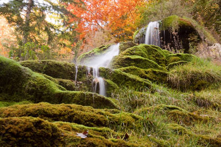 Sacred Waterfall. Tuefels Chilen. Autumn. Switzerland photo