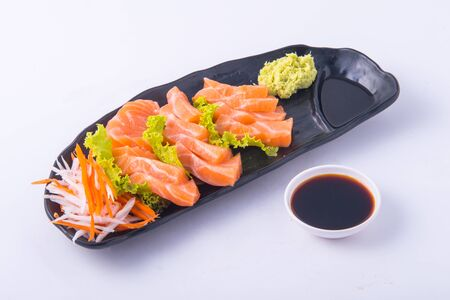 Sasimi salmon on white background at restaurant.