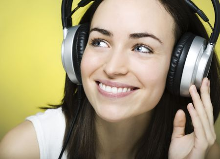 beautiful young girl enjoys listening to music Stock Photo - 6060084