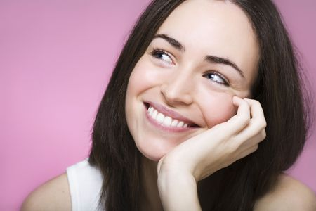 laughing face of a beautiful young woman photo