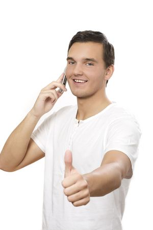 man talking on his cellphone and giving a thumbs up sign. Isolated on white.  photo