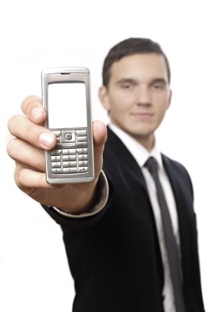 isolated business male holding a cell phone for communication. selective focus on phone