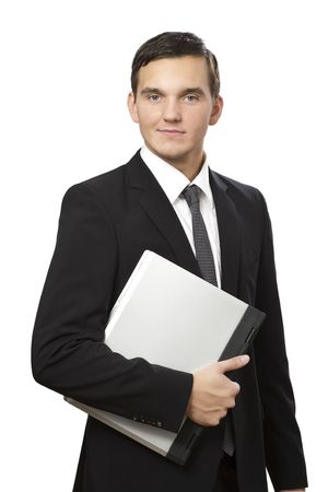 young business man standing and holding laptop on white  photo