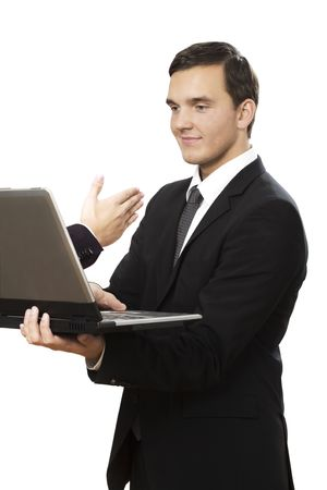 hand reaches out of laptop towards young businessman holding photo