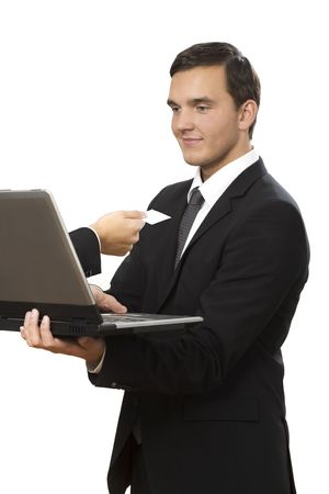 hand reaches out of laptop towards young businessman holding Stock Photo - 6090794