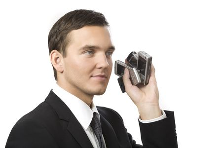 young businessman holding many phones in his hands photo