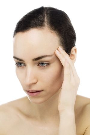 young woman with headache touching forehead photo