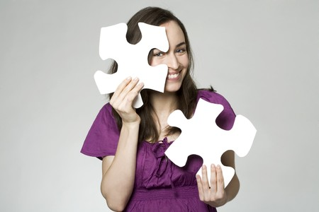 woman with a puzzle Stock Photo - 7010971
