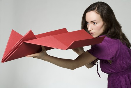 woman with paper airplane