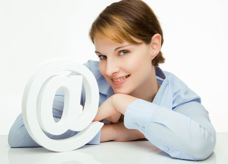 young woman holding an @ symbol in her hands Stock Photo