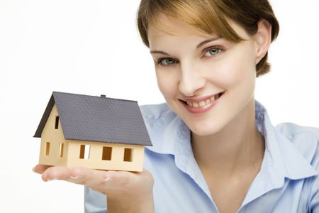 young friendly smiling businesswoman presenting a model house  Stock Photo