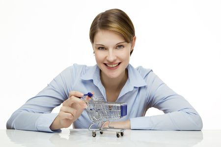 young woman with a miniature shopping cart Stock Photo