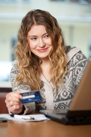 Young woman buys on the web photo