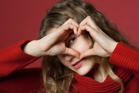 young women formed a heart with the hands photo