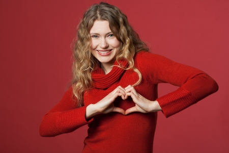 young women formed a heart with the hands Stock Photo - 8609823