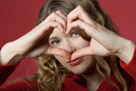 young women formed a heart with the hands