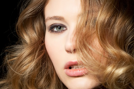 young woman presents her golden locks Stock Photo - 8609828