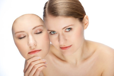 young woman with mask of her second face Stock Photo