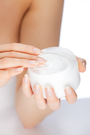 hands dipped in skin cream for skincare Stock Photo