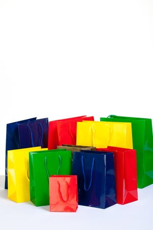 bunch of colourful shopping bags in diffrent sizes photo