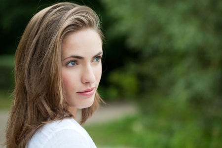 portrait of a beautiful woman outdoors in the green Stock Photo