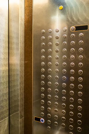 many buttons in cabin of modern elevator in skyscraper