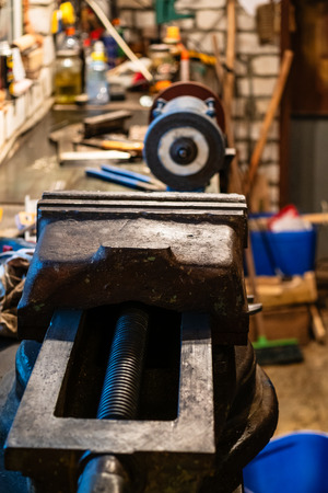 big metalworking vise on the table in the home workshop