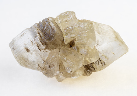 macro photography of natural mineral from geological collection - raw fluorite (fluorspar) stone on white background