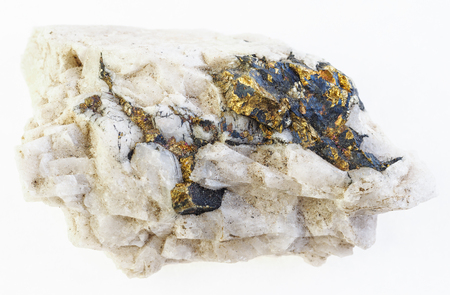 macro photography of natural mineral from geological collection - chalcopyrite in raw quartz stone on white background Stock Photo