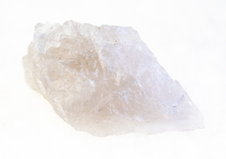 macro photography of natural mineral from geological collection - raw Quartz stone on white background